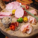 assortment of pork meats on a wooden serving tray