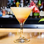 coconut martini drink with pomegranate garnish