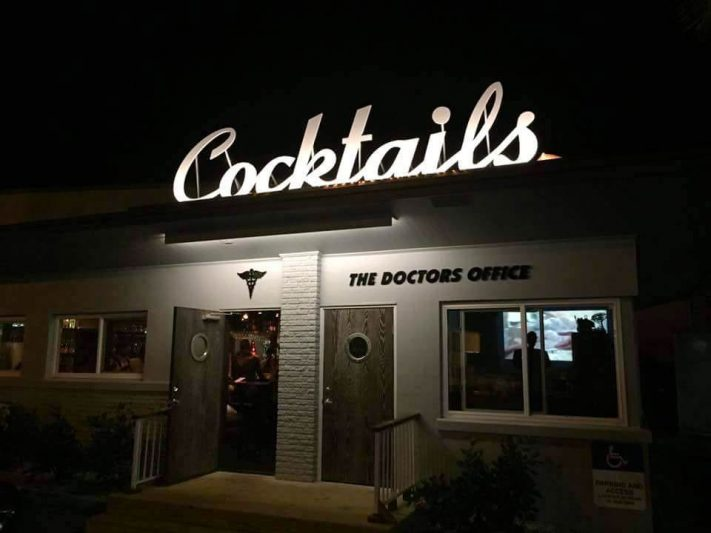 Outside of doctors office says cocktails on the top of the bar