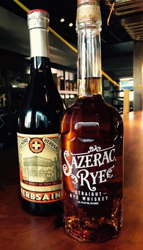 Sazerac Rye bottle and spirt of new orleans herbsain bottle