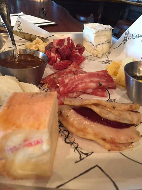 small assortment of meats, cheeses, and fruity dipping sauces