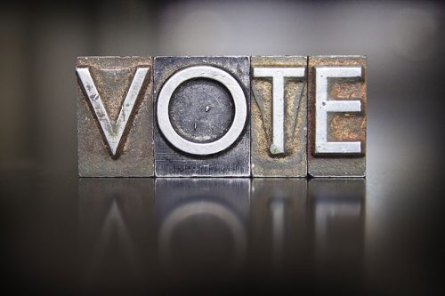 vote spelled with letterpress blocks